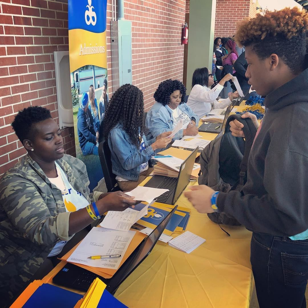 A student talks to an admissions specialist at an ASU Recruitment event
