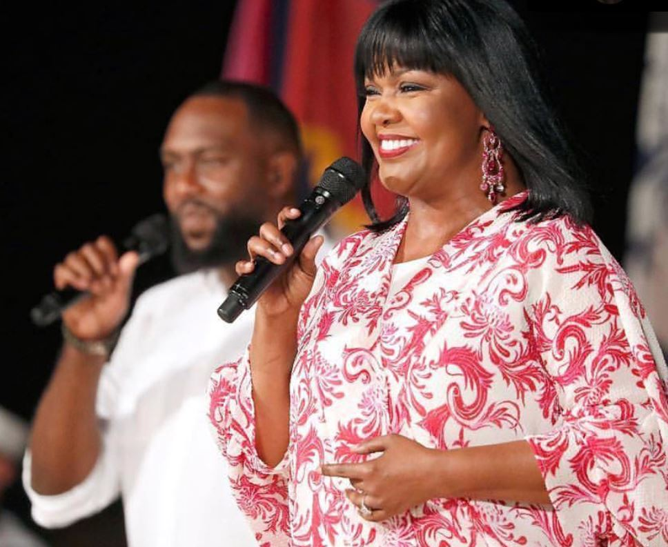 CeCe Winans performs with Martez Favis in the background
