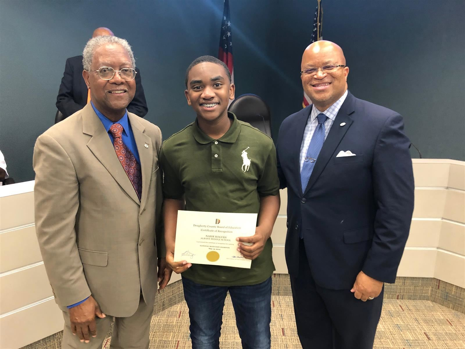 Nasir Rogers with Superintendent Kenneth Dyer and Vice Chair Dr. Dean Phinazee