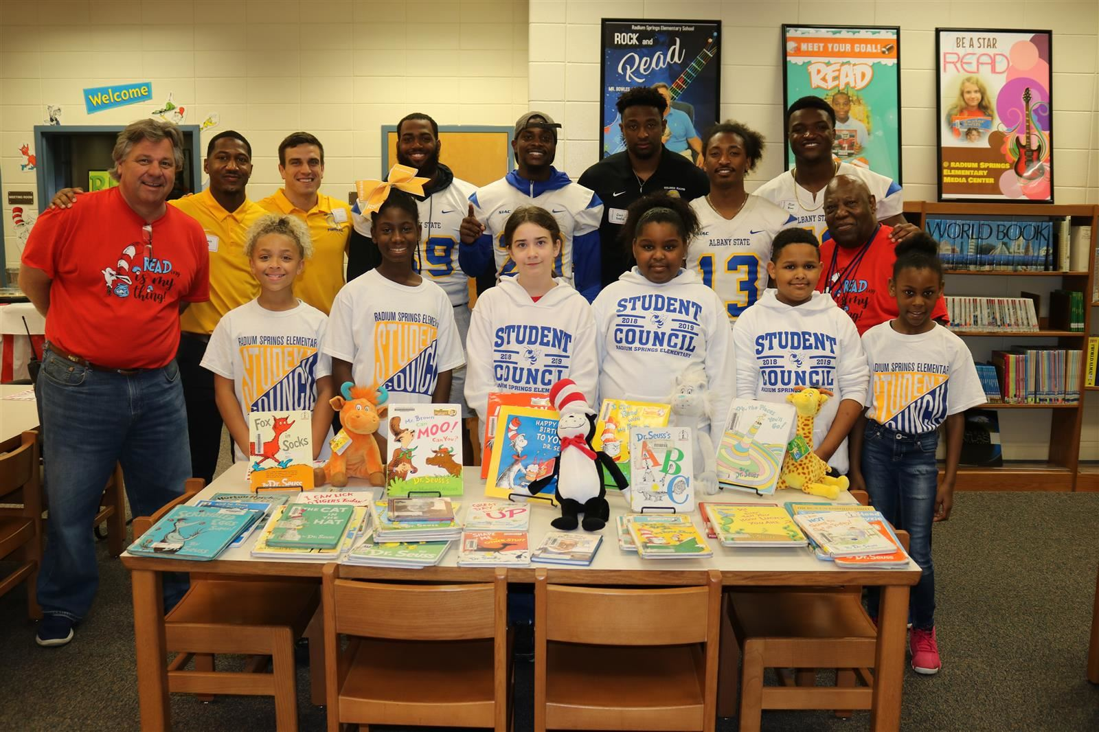 ASU Football players and coaches read to students