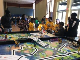 Wildcats robotics team members at the competition table